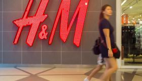 A woman seen walking in front of the H&M shop. Malaysia...